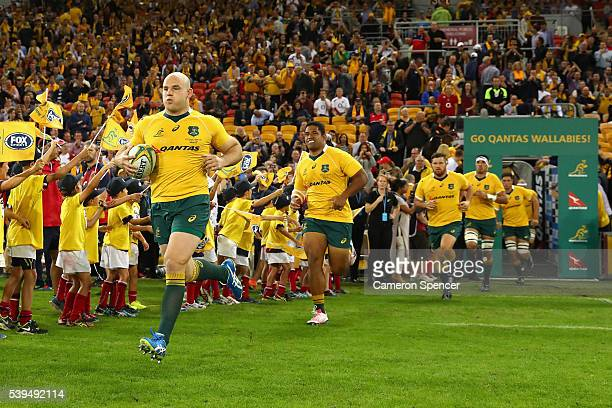 Stephen Moore of the Wallabies leads his team onto the field during the International Test match between the Australian Wallabies and England at...