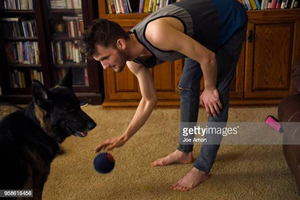 Stephen Morgan 22 playing with Darcy at his home in Broomfield Stephen came to live with Elizabeth Pate in December 2013 and was adopted into the...