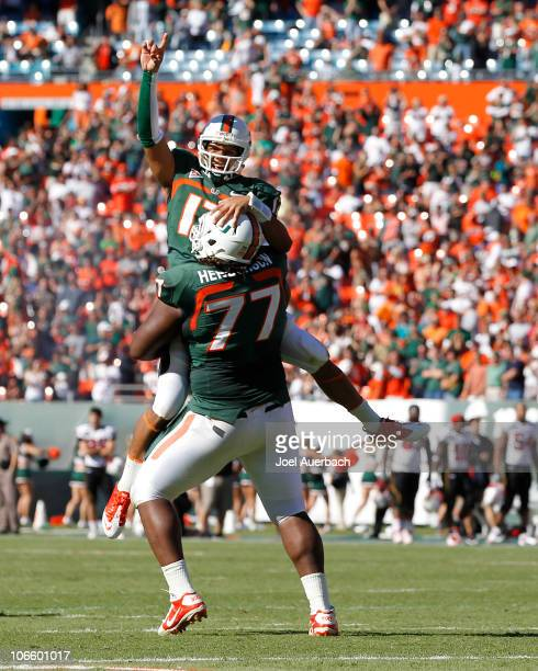 Stephen Morris is lifted by Seantrel Henderson of the Miami Hurricanes after throwing the winning touchdown against the Maryland Terrapins on...