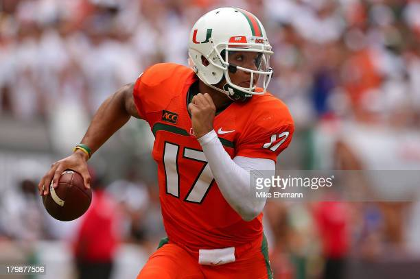 Stephen Morris of the Miami Hurricanes passes during a game against the Florida Gators at Sun Life Stadium on September 7 2013 in Miami Gardens...