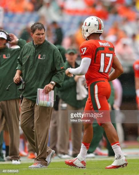 Stephen Morris of the Miami Hurricanes talks with head coach Al Golden during a game against the Virginia Cavaliers at Sun Life Stadium on November...