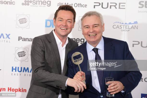 Stephen Mulhern and Eamonn Holmes pose in the winners room with the award for Entertainment Programme at the TRIC Awards 2017 at The Grosvenor House...