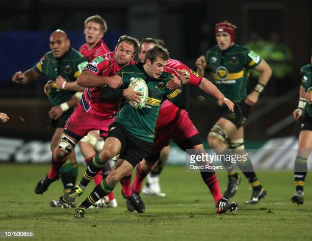 Stephen Myler of Northampton is tackled by Xavier Rush during the Heineken Cup Pool 1 match between Northampton Saints and Cardiff Blues at...