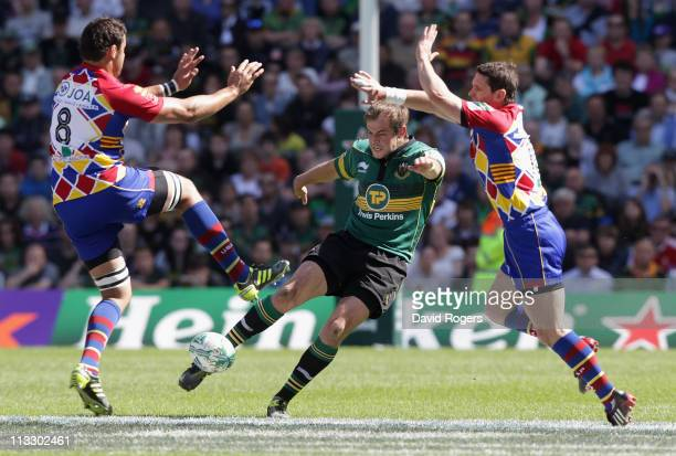 Stephen Myler of Northampton kicks the ball upfield past Damien Chouly and Nicolas Laharrague during the Heineken Cup semi final match between...