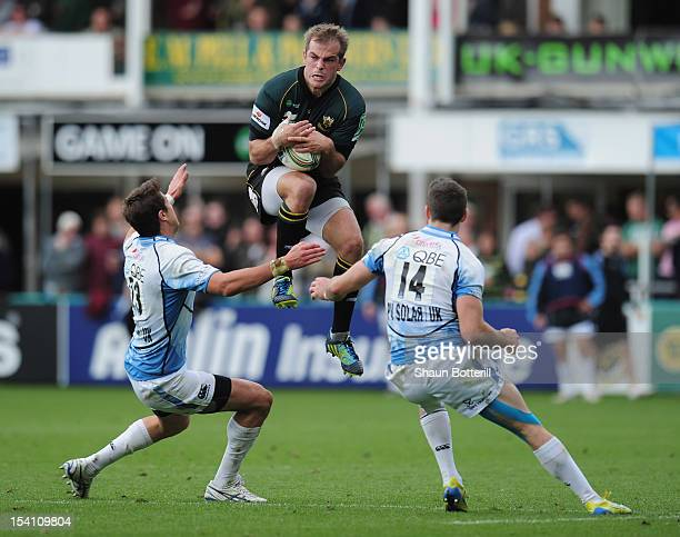 Stephen Myler of Northampton Saints out jumps Tommy Seymour and Peter Murchie of Glasgow Warriors during the Heineken Cup Round 1 match between...