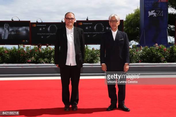 Stephen Nomura Scribble and Ryuichi Sakamoto walk the red carpet ahead of the 'Ryuichi Sakamoto Coda' screening during the 74th Venice Film Festival...