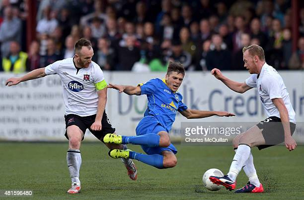 Stephen O'Donnell of Dundalk fouls Aliaksandr Karnitski of BATE Borisov during the Champions League 2nd round qualifying game at Oriel Park on July...