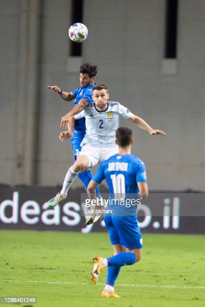 Stephen O'Donnell of Scotland jumps for the ball during the UEFA Nations League group stage match between Israel and Scotland at Netanya Stadium on...