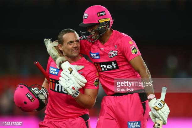 Stephen O'Keefe and Gurinder Sandhu of the Sixers celebrate winning the Big Bash League match between Sydney Sixers and the Melbourne Stars at...
