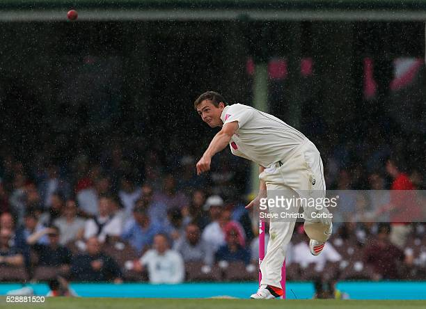 Stephen O'Keefe of Australia bowling in the rain during the first day of the third Test match between Australia and the West Indies at the Sydney...
