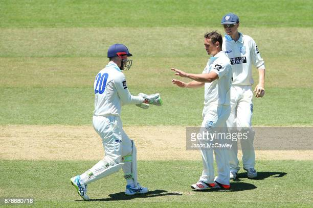 Stephen O'Keefe of NSW is congratulated by Peter Nevill after dismissing Glenn Maxwell of Victoria during day two of the Sheffield Shield match...