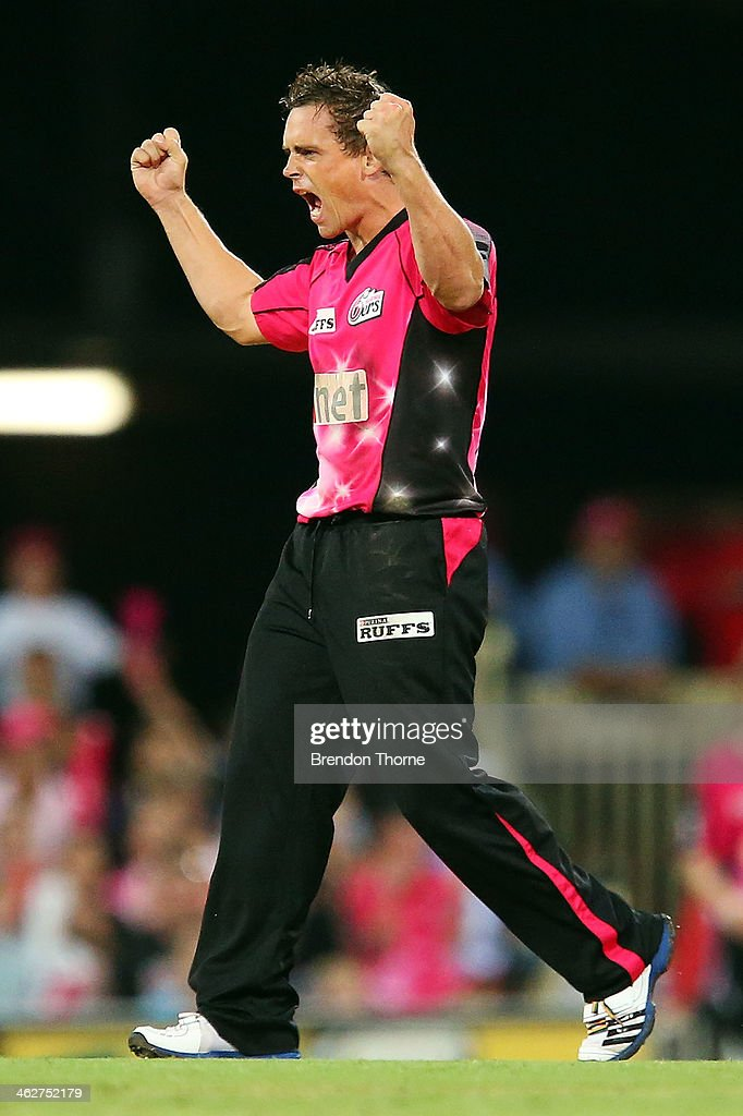Stephen O'Keefe of the Sixers celebrates after claiming the wicket of Jon Wells of the Hurricanes during the Big Bash League match between the Sydney Sixers and the Hobart Hurricanes at SCG on January 15, 2014 in Sydney, Australia.
