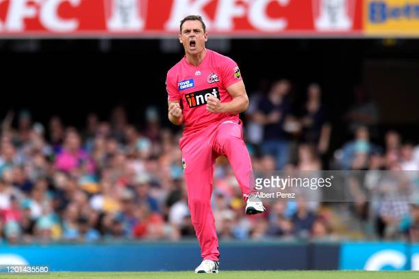 Stephen O'Keefe of the Sixers celebrates bowling out Chris Lynn of the Heat during the Big Bash League match between the Brisbane Heat and the Sydney...