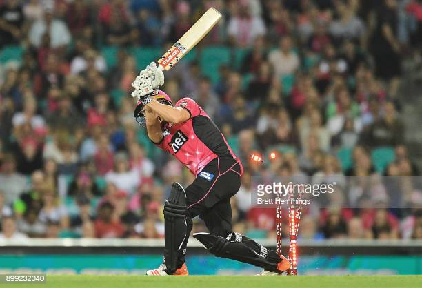 Stephen O'Keefe of the Sixers is bowled out by Michael Neser of the Strikers during the Big Bash League match between the Sydney Sixers and the...