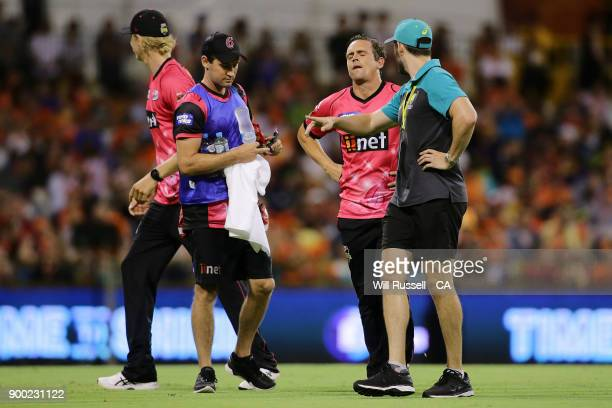 Stephen O'Keefe of the Sixers leaves the field after an injury during the Big Bash League match between the Perth Scorchers and the Sydney Sixers at...