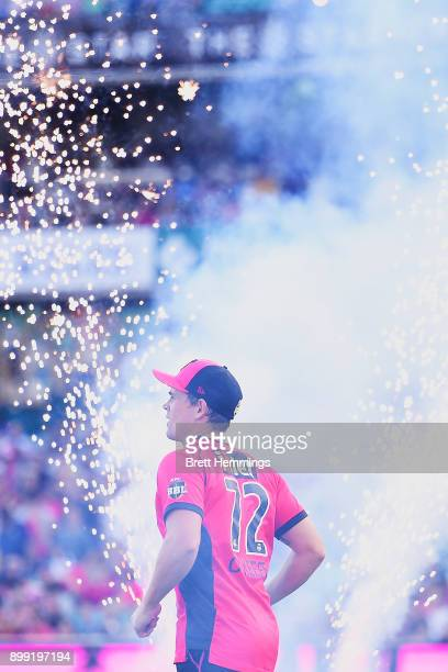 Stephen O'Keefe of the Sixers runs onto the field during the Big Bash League match between the Sydney Sixers and the Adelaide Strikers at Sydney...