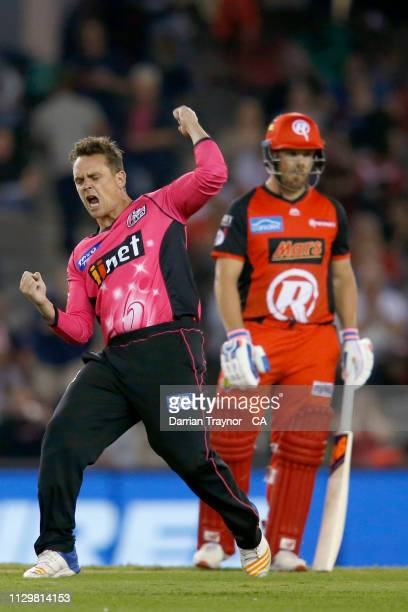 Stephen O'Keefe of the Sydney Sixers celebrates the wicket of Marcus Harris of the Renegades during the Big Bash League semi final between the...