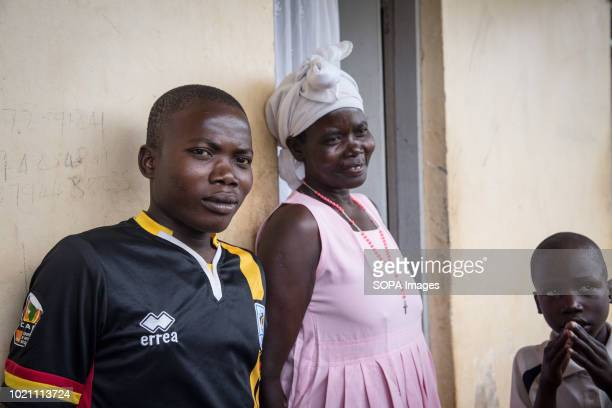 Stephen Okot seen with his family at a reunion between three escapees and their families who hadn't seen them in sixteen years The men were abducted...