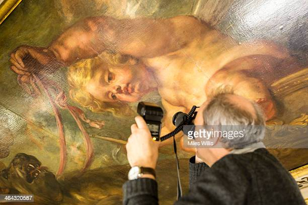 Stephen Paine of conservation experts Paine & Stuart photographs the 1634 Rubens ceiling for damage during a conditioning survey at Banqueting House...