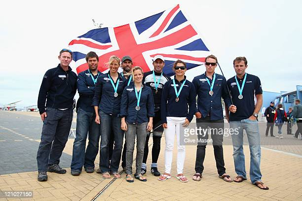 Stephen Park Andrew Simpson Saskia Clark Iain Percy Hannah Mills Ben Ainslie Bryony Shaw Paul Goodison and Nick Dempsey all of Great Britain pose...