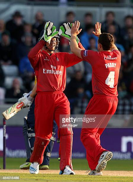 Stephen Parry of Lancashire Lightning celebrates the wicket of William Porterfield of Birmingham Bears with Jos Buttler during the Natwest T20 Blast...