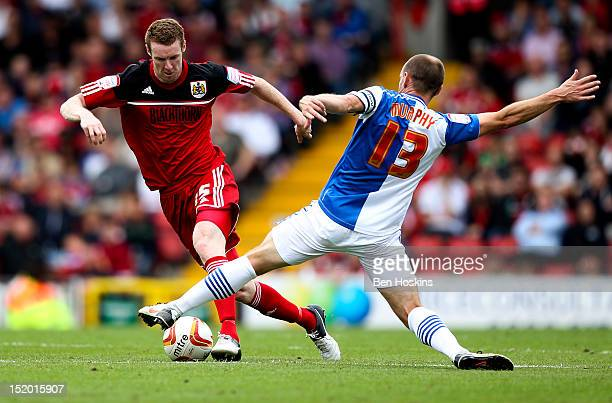 Stephen Pearson of Bristol skips past the challenge of Danny Murphy of Blackburn during the npower Championship match between Bristol City and...