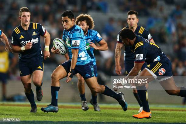 Stephen Perofeta of the Blues makes a break during the round 10 Super Rugby match between the Blues and the Highlanders at Eden Park on April 20 2018...