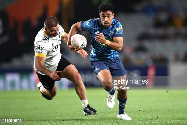 Stephen Perofeta of the Blues makes a break during the round 6 Super Rugby Aotearoa match between the Blues and the Hurricanes at Eden Park, on April...