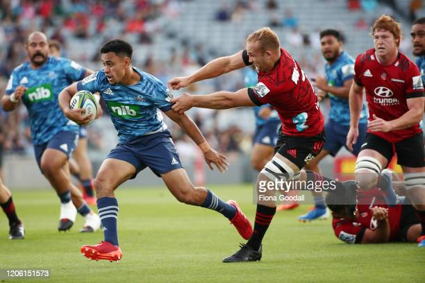 Stephen Perofeta of the Blues makes a break tackled by Tom Christie of the Crusaders during the round 3 Super Rugby match between the Blues and the...