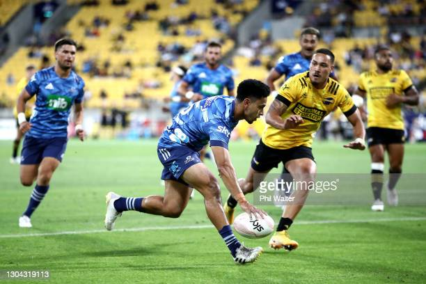 Stephen Perofeta of the Blues scores a try during the round one Super Rugby Aotearoa match between the Hurricanes and the Blues at Sky Stadium, on...