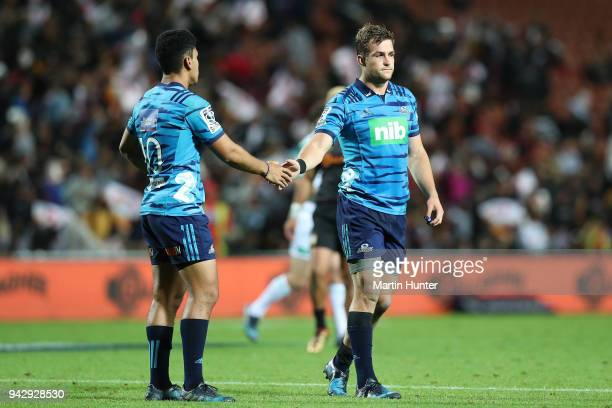 Stephen Perofeta of the Blues shakes hands with team mate Michael Collins after the round eight Super Rugby match between the Chiefs and the Blues at...