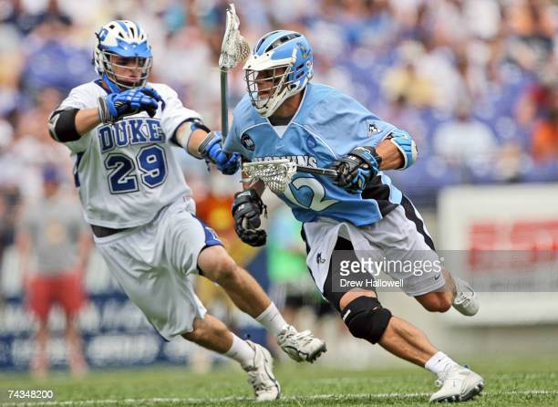 Stephen Peyser of Johns Hopkins is pursued by Mike Catalino of Duke on May 28 2007 at MT Bank Stadium in Baltimore Maryland Johns Hopkins University...
