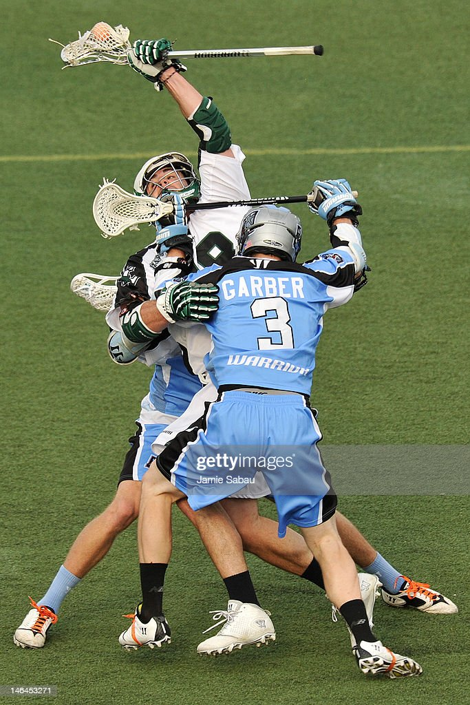 Stephen Peyser #18 of the Long Island Lizards is sandwiched by the defense of Connor Martin #88 of the Ohio Machine and Brett Garber #3 of the Ohio Machine in the first half on June 16, 2012 at Selby Stadium in Delaware, Ohio.