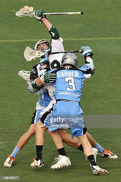 Stephen Peyser of the Long Island Lizards is sandwiched by the defense of Connor Martin of the Ohio Machine and Brett Garber of the Ohio Machine in...