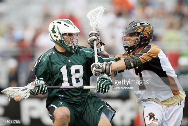 Stephen Peyser of the Long Island Lizards takes controls the ball against Steve DeNapoli of the Rochester Rattlers during their Major League Lacrosse...