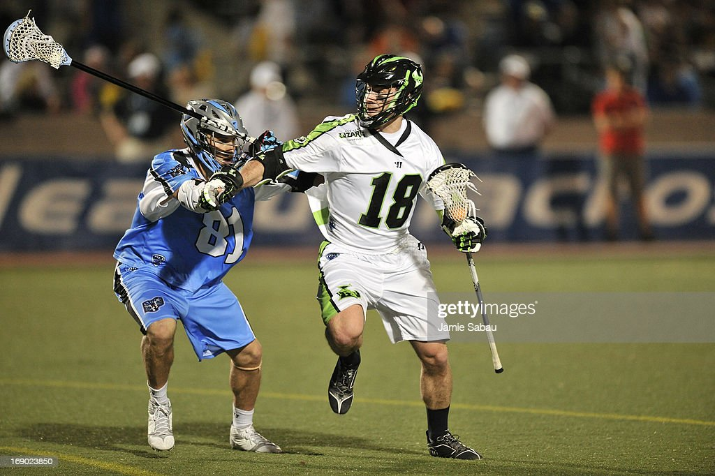 Stephen Peyser #18 of the New York Lizards controls the ball in the fourth period as Kyle Hartzell #81 of the Ohio Machine defends on May 18, 2013 at Selby Stadium in Delaware, Ohio. New York defeated Ohio 14-8.