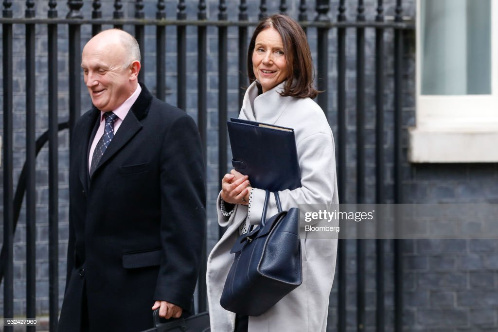 Stephen Phipson, outgoing head of arms exports at Britains International Trade Department, left, and Carolyn Fairbairn, director general of the Confederation of British Industry (CBI), arrive for a meeting of the Business Advisory Council at Downing Street in London, U.K., on Thursday, March 15, 2018. U.K. Prime Minister Theresa May is due to meet business leaders on Thursday to discuss Britain's departure from the European Union. Photographer: Luke MacGregor/Bloomberg via Getty Images