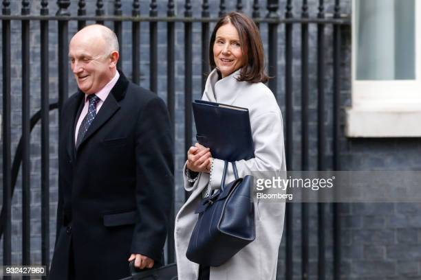 Stephen Phipson outgoing head of arms exports at Britains International Trade Department left and Carolyn Fairbairn director general of the...