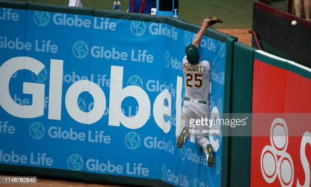 Stephen Piscotty climbs the wall but can't get to this home run by Asdrubal Cabrera of the Texas Rangers during the sixth inning of the Oakland...