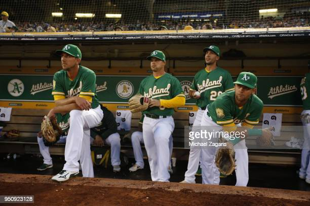 Stephen Piscotty Jake Smolinski Matt Olson and Chad Pinder of the Oakland Athletics wait to take the field prior to the game against the Los Angeles...