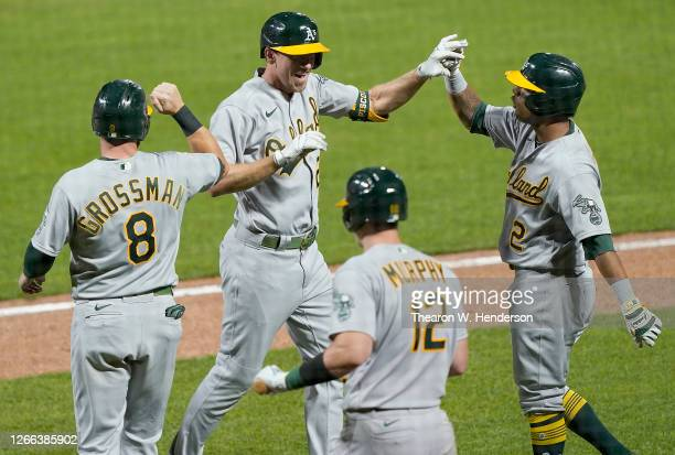 Stephen Piscotty, Khris Davis, Sean Murphy and Robbie Grossman of the Oakland Athletics celebrate after Piscotty hit a game-tying grand slam against...