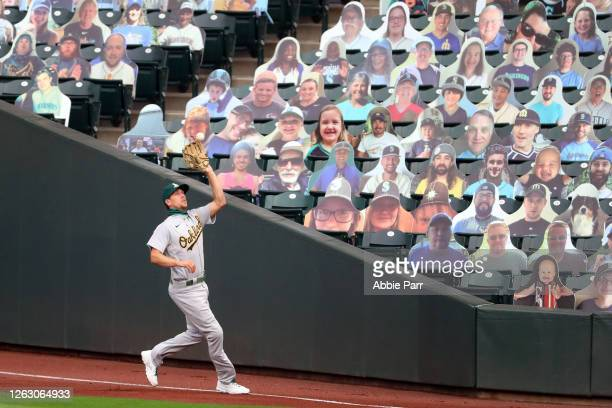 Stephen Piscotty of the Oakland Athletics catches a fly out in the fourth inning against the Seattle Mariners during their Opening Day game at...