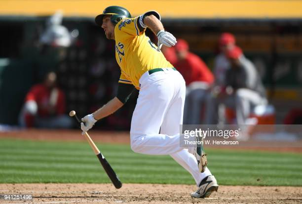 Stephen Piscotty of the Oakland Athletics hits a bases loaded tworun rbi single against the Los Angeles Angels of Anaheim in the bottom of the six...
