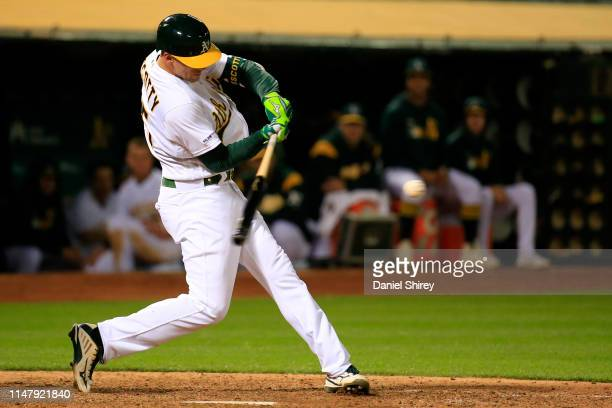Stephen Piscotty of the Oakland Athletics hits a walk off home run during the thirteenth inning against the Cincinnati Reds at OaklandAlameda County...