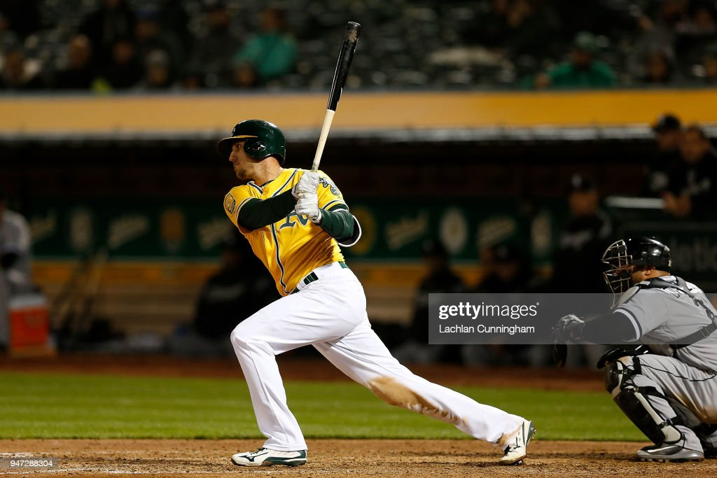 Stephen Piscotty #25 of the Oakland Athletics hits an RBI single in the eighth inning against the Chicago White Sox at Oakland Alameda Coliseum on April 16, 2018 in Oakland, California.