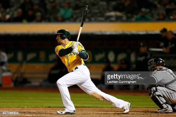 Stephen Piscotty of the Oakland Athletics hits an RBI single in the eighth inning against the Chicago White Sox at Oakland Alameda Coliseum on April...