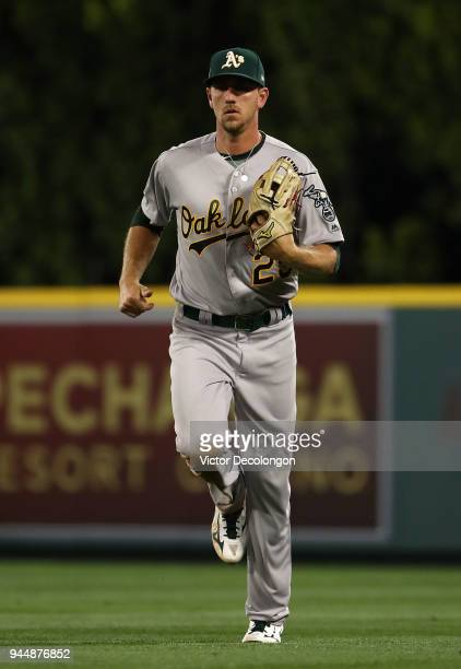 Stephen Piscotty of the Oakland Athletics jogs back to the dugout after the fifth inning during the MLB game against the Los Angeles Angels of...