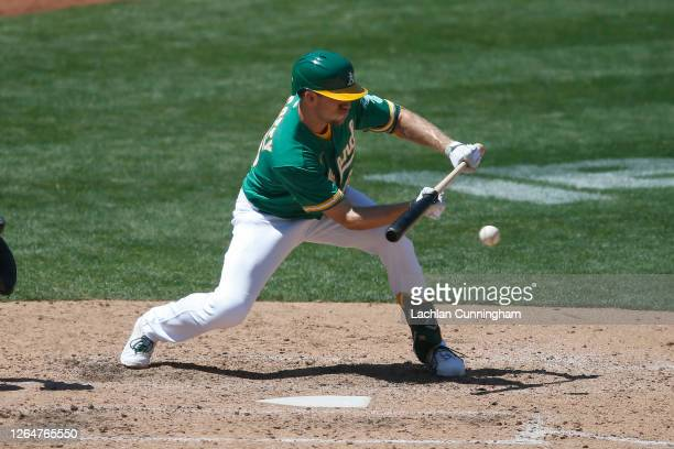 Stephen Piscotty of the Oakland Athletics lays down a sacrifice bunt in the bottom of the seventh inning against the Texas Rangers at OaklandAlameda...