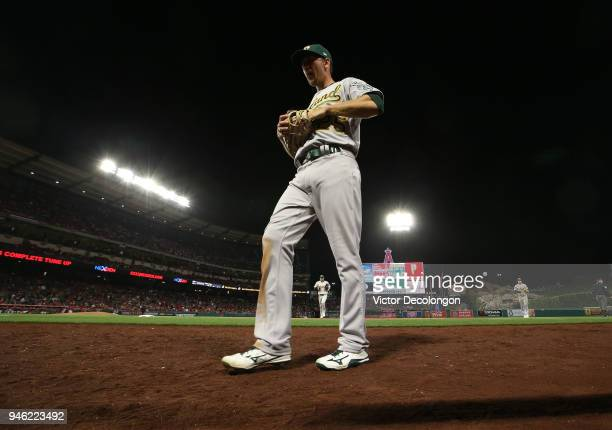Stephen Piscotty of the Oakland Athletics walks back to the dugout for the ninth inning during the MLB game against the Los Angeles Angels of Anaheim...