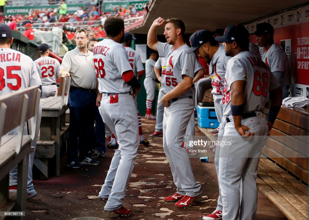 Stephen Piscotty #55 of the St. Louis Cardinals and Jose Martinez #58 of the St. Louis Cardinals dance after shaking hands with each other prior to the start of the game against the Cincinnati Reds at Great American Ball Park on September 19, 2017 in Cincinnati, Ohio.